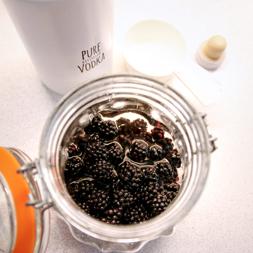 Step 1 - Add the vodka to the blackberries